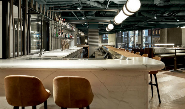 A Retro Café in Amsterdam Boasts a White Marble Bar and Exposed Pipes FEAT